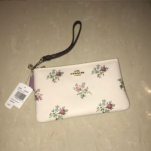 Coach wristlet with flower details
